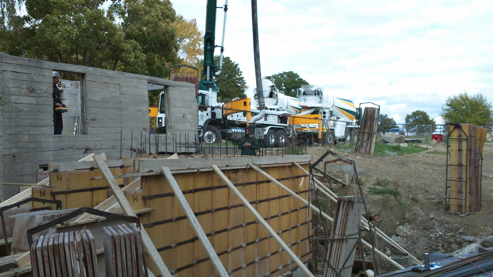 pumping concrete into forms for walls