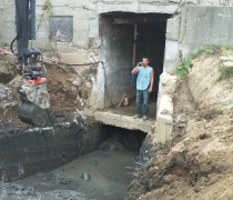 excavating to expose lower turbine pit exit