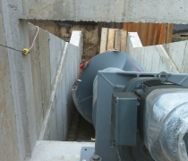 archimedes screw bolted in place ready to be cast in place with concrete behind the stainless steel trough