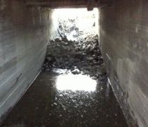 Existing intake channel under driveway